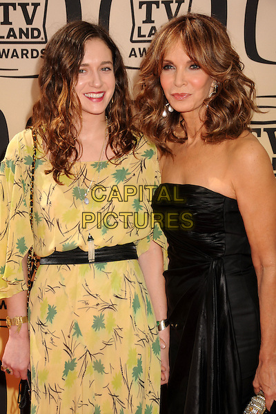 SPENCER MARGARET RICHMOND & JACLYN SMITH .8th Annual TV Land Awards - Arrivals, at Sony Pictures Studios,  Culver City, California, USA, 17th April 2010..half length daughter mother mum mom dress strapless black earrings wavy  hair dangly green yellow print waist belt chain strap bag family .CAP/ADM/BP.©Byron Purvis/AdMedia/Capital Pictures.