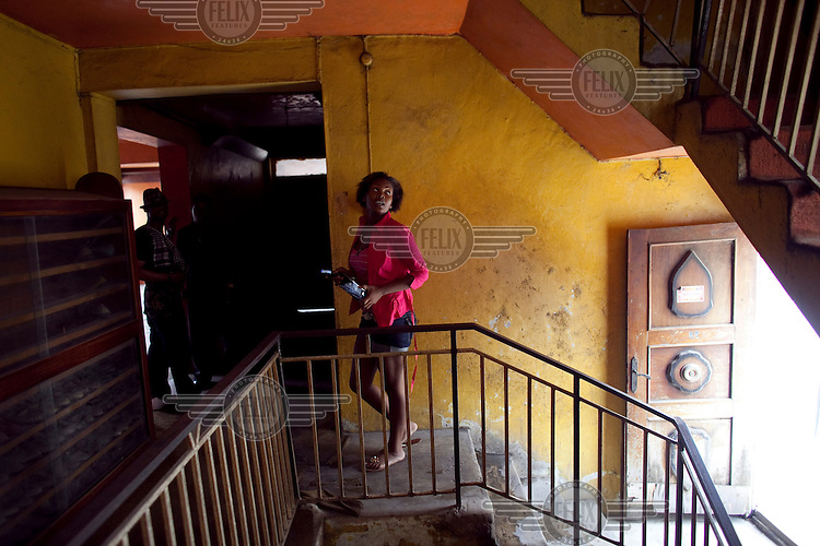 Monturayo Anikulapo Kuti, daughter of highlife and Afrobeat singer Fela Kuti, climbs the stairs of her house.