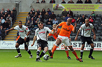 ATTENTION SPORTS PICTURE DESK<br /> Pictured: Craig Beattie of Swansea (L)  tackled by Alex Baptiste of Blackpool (R)<br /> Re: Coca Cola Championship, Swansea City Football Club v Blackpool at the Liberty Stadium, Swansea, south Wales. Saturday 24 October 2009