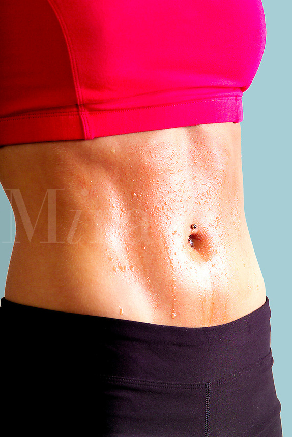 Beautiful female torso with closeup of abs