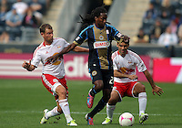 CHESTER, PA - OCTOBER 27, 2012:  Keon Daniel (26) of the Philadelphia Union breaks past  Teemu Tainio (6) and  Rafa Marquez (4) of the New York Red Bulls during an MLS match at PPL Park in Chester, PA. on October 27. Red Bulls won 3-0.