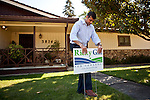 Republican congressional candidate Ricky Gill plants a campaign sign in a supporter's front yard in Stockton, Calif., September 18, 2012.