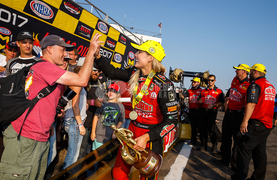Aug 20, 2017; Brainerd, MN, USA; NHRA top fuel driver Leah Pritchett celebrates with fans after winning the Lucas Oil Nationals at Brainerd International Raceway. Mandatory Credit: Mark J. Rebilas-USA TODAY Sports