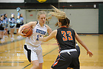 Ariana Lewis drives against West's Gillian Huss. Photo for the Star by Michael Dinneen