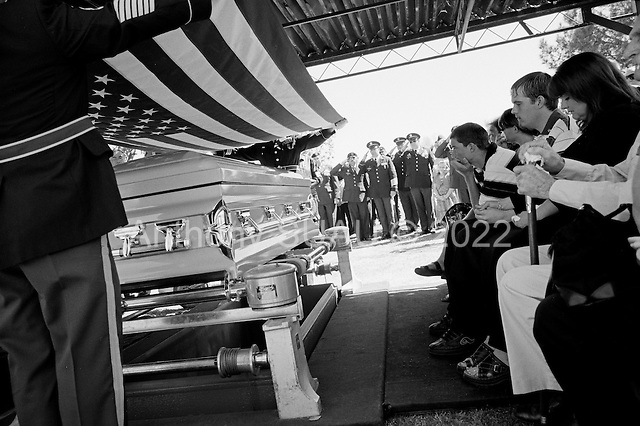 Tucson, Arizona.USA.March 16, 2007..At the Evergreen Cemetery Lori Kasson, the widow of Staff Sgt. Darrel D. Kasson, 43, of Florence, Arizona with her three children (to her right) Jeremy (19), Dale (15), and daughter Lisa Varnes (22) at the funeral services for her husband. He died March 4 in Tikrit, Iraq, of wounds suffered when an improvised explosive device detonated near his vehicle at Bayji, Iraq. He was assigned to the 259th Security Forces Company, Phoenix.