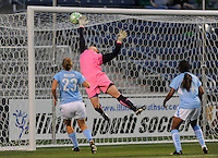 #1 Caroline Jonsson of the Chicago Reds tries to reach for a shot on goal, but can not get the stop.#9 Eniola Aluko  of St. Louis Athletica scored the goal, her first of two. Athletica beat the Red Stars 2-0...