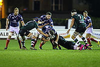 Neale Patrick of London Scottish (4 Blue) is tackled by TJ Harris of Nottingham Rugby (2 Green) during the Greene King IPA Championship match between London Scottish Football Club and Nottingham Rugby at Richmond Athletic Ground, Richmond, United Kingdom on 16 October 2015. Photo by David Horn.