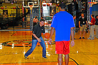 30 September, 2010, Kansas City, Kansas USA.Denny Hamlin play ball with Wayne Simien on the center court at The College Basketball Experience..©2010, F. Peirce Williams, USA.