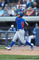 Michael Cruz (8) of the South Bend Cubs follows through on his swing against the West Michigan Whitecaps at Fifth Third Ballpark on June 10, 2018 in Comstock Park, Michigan. The Cubs defeated the Whitecaps 5-4.  (Brian Westerholt/Four Seam Images)