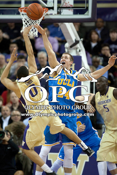 Feb 2, 2012:  UCLA's #24 Travis Wear tries to swat away #0 Abdul Gaddy of Washington's shot.  Washington defeated UCLA 71-69 at Alaska Airlines Arena Seattle, Washington...