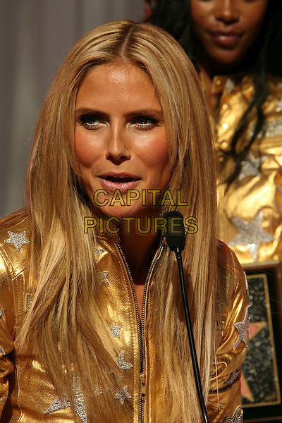 HEIDI KLUM.Victoria's Secret Angels Receive Award of Excellence from Honorary Mayor of Hollywood Johnny Grant in Celebration of the Victoria's Secret 25th Anniversary, Hollywood, California, USA..November 13th, 2007.headshot portrait gold silver metallic star microphone funny face .CAP/ADM/RE.©Russ Elliot/AdMedia/Capital Pictures.
