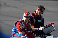 Apr 17, 2009; Avondale, AZ, USA; NASCAR Sprint Cup Series driver Mark Martin (left) with crew chief Alan Gustafson during qualifying for the Subway Fresh Fit 500 at Phoenix International Raceway. Mandatory Credit: Mark J. Rebilas-