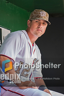 27 May 2013: Washington Nationals outfielder Tyler Moore sits in the dugout prior to facing the Baltimore Orioles at Nationals Park in Washington, DC. The Orioles defeated the Nationals 6-2, taking the Memorial Day, first game of their interleague series. Mandatory Credit: Ed Wolfstein Photo *** RAW (NEF) Image File Available ***