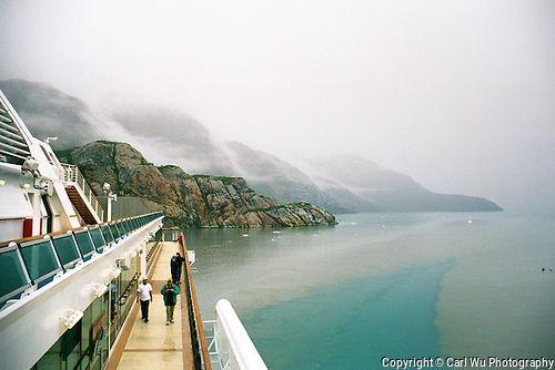 The Ship Slowly Turns As It Stirs The Calm Waters Of Alaska, On A Misty Day