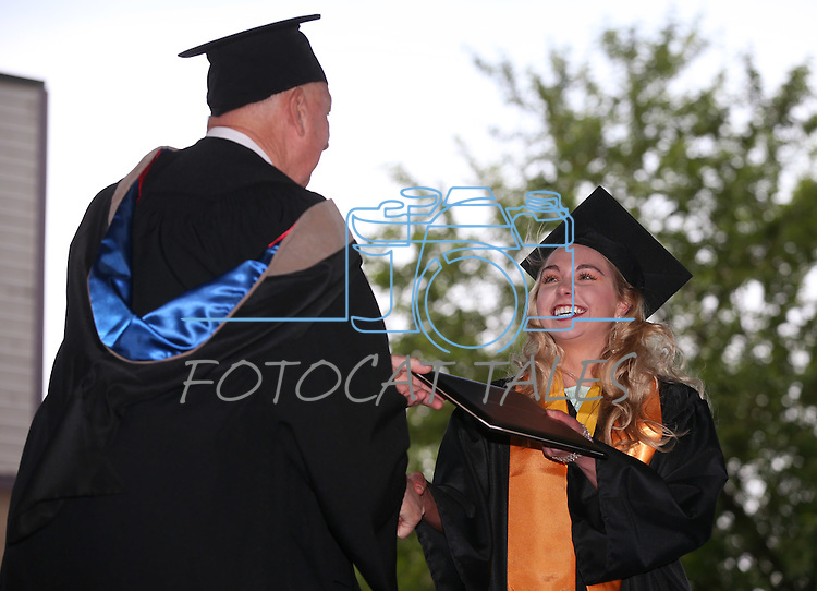 Interim President Chester Burton congratulates Coraleigh Bales during at the Western Nevada College commencement at the Pony Express Pavilion, in Carson City, Nev., on Monday, May 19, 2014. <br /> Photo by Cathleen Allison/Nevada Photo Source