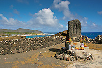 Japanese shrine rock god altar: a Japanese fishing shrine with a carving of a Japanese guardian god overlooking dangerous waterways along Kalaniana'ole Highway near Sandy Beach, East O'ahu.