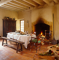 The kitchen/dining room has a magnificent working fireplace