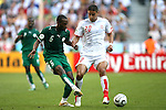 14 June 2006: Omar Al Ghamdi (KSA) (6) plays the ball past Hamed Namouchi (TUN) (20). Tunisia tied Saudi Arabia 2-2 at the Allianz Arena in Munich, Germany in match 16, a Group H first round game, of the 2006 FIFA World Cup.