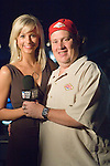 Professional poker player, Gavin Smith, was presented with a watch signifying that he is the World Poker Tour Player of the Year for Season 4.  Here he poses with Season 5 host, Sabina Gadecki.