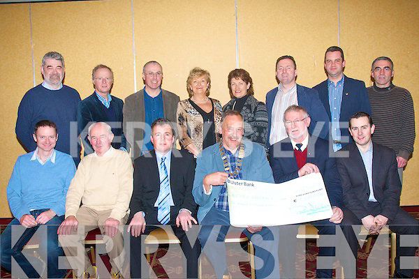 Food for Thought: Paul Salbury, President of Tralee Lions club, hands over a cheque for EUR1,500 to Michael O Suilleabhain, PRO Kerry Hospice in the Meadowlands Hotel, Tralee on Tuesday evening, after their successful food fair in the Brandon Hotel, Tralee recently, which was sponsored by Garvey's Supervalu. Pictured seated l-r: Brendan Kenny, Michael Buckley, Tim Moynihan (Garvey's SV), Paul Salbury, Michael O Suilleabhain and Paul O'Connor (Garvey's SV). Back l-r: Brendan Fitzgerald, Teddy Reynolds, Mark Bennett, Deirdre McElligott, Margaret O'Shea (Hospice), Dave Rath, Eoin Porter and John Moynihan.