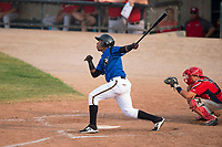 Missoula Osprey right fielder David Sanchez (16) follows through on his swing in front of catcher Griffin Barnes (28) during a Pioneer League game against the Orem Owlz at Ogren Park Allegiance Field on August 19, 2018 in Missoula, Montana. The Missoula Osprey defeated the Orem Owlz by a score of 8-0. (Zachary Lucy/Four Seam Images)