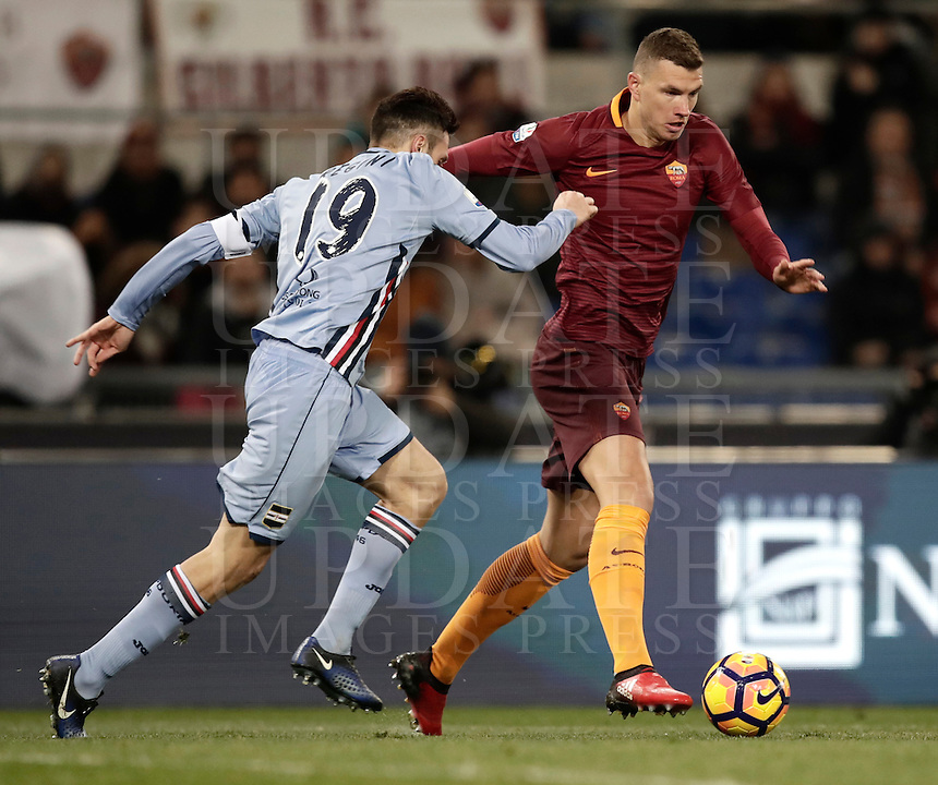 Calcio, ottavi di finale di Tim Cup: Roma vs Sampdoria. Roma, stadio Olimpico, 19 gennaio 2017.<br /> Roma's Edin Dzeko, right, is challenged by Sampdoria's Vasco Regini during the Italian Cup round of 16 football match between Roma and Sampdoria at Rome's Olympic stadium, 19 January 2017.<br /> UPDATE IMAGES PRESS/Isabella Bonotto