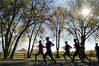 A training group of Kenyan runners passes Haystack Mountain, left, on a 30-kilometer training run, Wednesday, Oct. 11, 2006. Boulder, Colo. is a mecca for runners due to a variety of terrain and altitudes available for training. (Kevin Moloney for the New York Times)