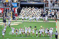 September 28, 2013 - Orlando, FL, U.S: UCF Knights take the field for 1st half NCAA football game action between the South Carolina Gamecocks and the UCF Knights at Bright House Networks Stadium in Orlando, Fl