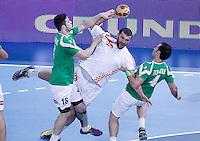 Algeria's Hichem Kaabache (l) and Hamza Zoauaoui (r) and Croatia's Zeljko Musa during 23rd Men's Handball World Championship preliminary round match.January 14,2013. (ALTERPHOTOS/Acero) 7NortePhoto