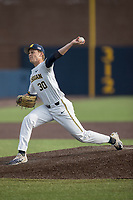 Michigan Wolverines pitcher Michael Hendrickson (30) delivers a pitch to the plate against the Michigan State Spartans during the NCAA baseball game on April 18, 2017 at Ray Fisher Stadium in Ann Arbor, Michigan. Michigan defeated Michigan State 12-4. (Andrew Woolley/Four Seam Images)
