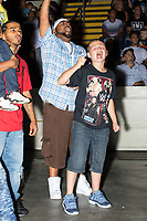 Audience members cheer during a WWE Live Summerslam Heatwave Tour event at the MassMutual Center in Springfield, Massachusetts, USA, on Mon., Aug. 14, 2017.