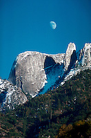 """Sequoia National Park in winter. The """"""""Castle Rocks"""""""" and quarter moon over them in blue sky. California"""