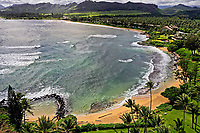 Aerial view above Lae Nani Vacation Rentals, looking south over Wailua, Kaua'i.