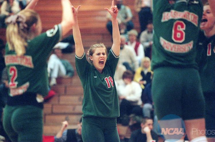 7 Dec 1996:  Washington University outside hitter Emmy Sjogren (18) reacts to a point earned by her team during the Division 3 Women's Volleyball Championship hosted by the University of Wisconsin-Oshkosh at the Kolf Sports Center in Oshkosh, WI. Washington University defeated Juniata College 3 sets to 0 for the championship title. Pete Zuzga/NCAA Photos