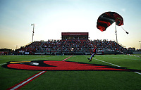 NWA Democrat-Gazette/ANDY SHUPE<br /> Joe Caldwell of Skydive Fayetteville lands Friday, Sept. 6, 2019, at midfield before the start of the Cardinals' game with Prairie Grove to open the school's new stadium. Visit nwadg.com/photos to see more photographs from the game.