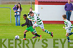 Kingdom Boys Abbey Yusuf gets passed Listowel Celtic's Dan McKenna in the JK Sports U12's premier division at Cahermoneen, Tralee on Saturday.