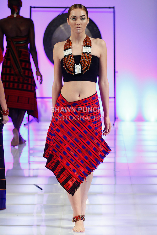 Model walks runway in an outfit from the Ikali Sukhalu collection, for the Northeast Indian Academy of the Performing Arts fashion show, during Couture Fashion Week Fall 2014, on February 15, 2014.