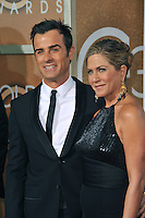 Jennifer Aniston &amp; Justin Theroux at the 72nd Annual Golden Globe Awards at the Beverly Hilton Hotel, Beverly Hills.<br /> January 11, 2015  Beverly Hills, CA<br /> Picture: Paul Smith / Featureflash