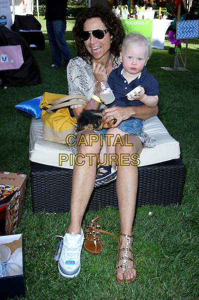 MINNIE DRIVER & HENRY STORY DRIVER.Minnie Driver Putting on her New Shape-ups Sketchers For a Stroll on the park with Son Henry Story Driver held In Los Angeles, California, USA..May 7th, 2010.full length mother mom mum son family kid child blue top jean denim shorts dog animal pet food can drink beverage sunglasses shades mouth open aviators grey gray black print dress trainers sneakers sandals shoes sitting smiling .CAP/ADM/KB.©Kevan Brooks/AdMedia/Capital Pictures.