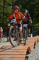 NWA Democrat-Gazette/BEN GOFF @NWABENGOFF<br /> Riders use a portable pump track set up by Fast Rack Modern Cycling Solutions of Fort Smith Sunday, June 11, 2017, during the Battle for Townsend's Ridge mountain bike race at Hobbs State Park - Conservation Area near Rogers. The cross country race, presented by Ozark Off Road Cyclists, is part of the Arkansas Mountain Bike Championship Series. This year entry fees for racers 14 and younger were covered by Ozark Off Road Cyclists.