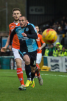 Michael Harriman of Wycombe Wanderers  chases down the ball during the Sky Bet League 2 match between Wycombe Wanderers and Luton Town at Adams Park, High Wycombe, England on 6 February 2016. Photo by Claudia Nako.