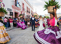Calendas are traditional street celebration, they happen almost daily in Oaxaca to celebrate weddings, batisms and other special moments. This Calenda was to celebrate the wedding of Silverio and Ameyali Dominguez. Oaxaca City, Oaxaca, Mexico