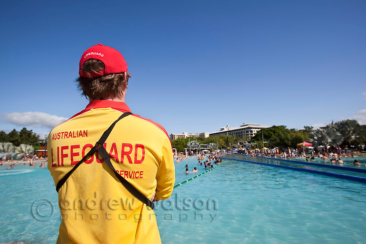 Lifesguard watching over swimmers at the Esplanade Lagoon.  Cairns, Queensland, Australia