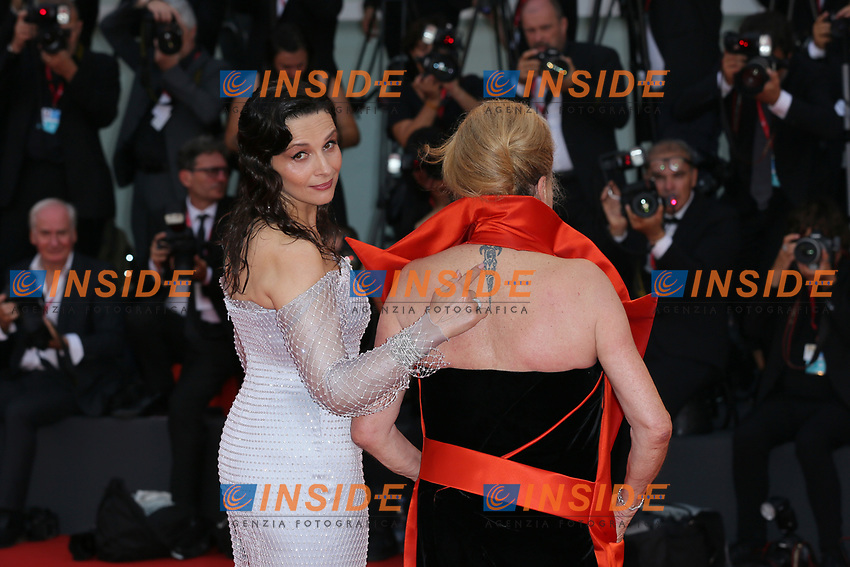 """VENICE, ITALY - AUGUST 28: Juliette Binoche and Chaterine Deneuve walk the red carpet ahead of the Opening Ceremony and the """"La Verite"""" (The Truth) screening during the 76th Venice Film Festival at Sala Grande on August 28, 2019 in Venice, Italy., 2019 in Venice, Italy. (Photo by Marck Cape/Inside Foto)<br /> Venezia 28/08/2019"""