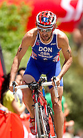 27 MAY 2012 - MADRID, ESP - Tim Don (GBR) of Great Britain on the bike during the elite men's 2012 World Triathlon Series round in Casa de Campo, Madrid, Spain (PHOTO (C) 2012 NIGEL FARROW)