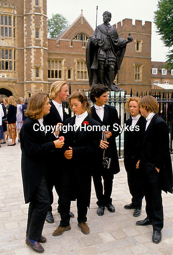 Girls sisters dress up in brothers traditional school uniform UK Eton College.