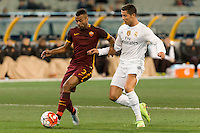 Melbourne, 18 July 2015 - Cristiano Ronaldo of Real Madrid and Ashley Cole of AS Roma fight for the ball in game one of the International Champions Cup match at the Melbourne Cricket Ground, Australia. Roma def Real Madrid 7-6 Penalties. Photo Sydney Low/AsteriskImages.com