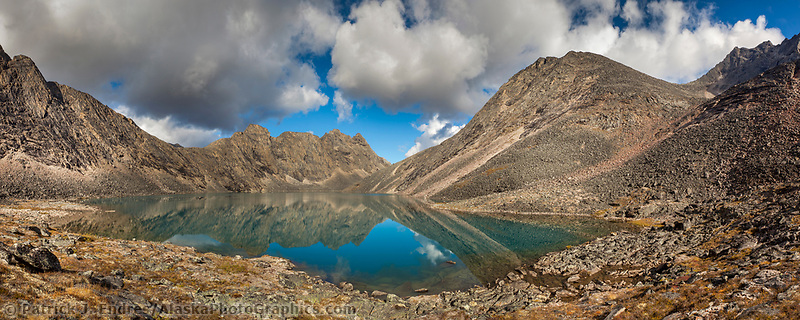 Panorama of crystal clear blue water mountain lake in the Arrigetch Peaks, Gates of the Arctic National Park, Alaska.