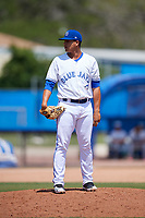 Dunedin Blue Jays relief pitcher Juliandry Higuera (21) looks in for the sign during a game against the Daytona Tortugas on April 22, 2018 at Dunedin Stadium in Dunedin, Florida.  Daytona defeated Dunedin 5-1.  (Mike Janes/Four Seam Images)