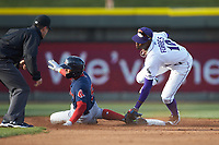 Santiago Espinal (5) of the Salem Red Sox slides into second base ahead of the tag by Ti'Quan Forbes (10) of the Winston-Salem Dash as umpire Matthew Brown looks on at BB&T Ballpark on April 21, 2018 in Winston-Salem, North Carolina.  The Dash walked-off the Red Sox 4-3.  (Brian Westerholt/Four Seam Images)
